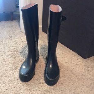 Black rubber sole rain boots. Size 6.
